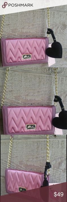 Betsey Johnson Mauve Clutch Purse 👛 nwt This purse is so beautiful!  Gorgeous mauve satin color with high quality hardware accents - LOVE.  Brand new with tags and mirror protectant sticker in tact.  Room for credit cards, etc 💳. LBLILLY model Betsey Johnson Bags