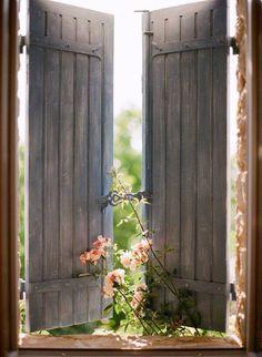 Simple but elegant plank shutters.