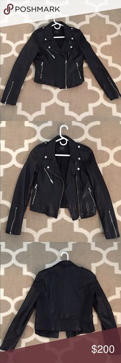 ZARA black (genuine) leather jacket REAL LEATHER JACKET. Worn only a few times (I'm selling it because I'm trying to become more animal conscious, otherwise I'd keep it because it's beautifully made and a gorgeous leather). Says LARGE but definitely fits more like a SIZE 4-6. Falls just above the hip, with nice long sleeves. Looks great over dresses, or just a tshirt and jeans. Has lived in a non-smoking home its whole life. Deserves to be loved and worn so please make an offer! Zara Jackets…