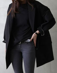 Consider teaming a black coat with dark grey skinny jeans for a glam and trendy getup. Shop this look on Lookastic: https://lookastic.com/women/looks/black-coat-black-crew-neck-sweater-charcoal-skinny-jeans/16149 — Black Crew-neck Sweater — Black Coat — Black Leather Belt — Charcoal Skinny Jeans