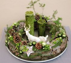 Candles & Deer on a tray complete this centerpiece with a grapevine wreath decorated with pinecones, berries, moss, ornaments Floravisionen - Adventskranz - Weihnachten - DaWanda