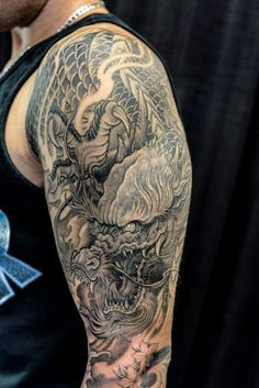 Chronic Ink Tattoo - Toronto Tattoo Half sleeve dragon tattoo done by Winson.