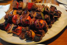 Grilled steak kabobs with peppers and red onions. - Feel free to share on Pinterest
