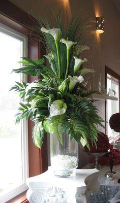 Large arrangement, mostly foliage.