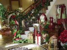 Decorating Ideas: Nook Decoration Near The Staircase With A Santa Figure Small Christmas Tree And A Console Filled With Some Gifts: Stunning Christmas Staircase Decorating Ideas