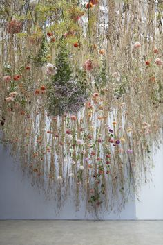 A 'meadow' was conjured to hang upside down in the glass roof of a London mews studio.