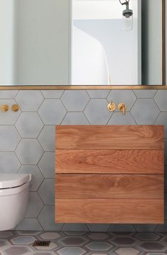 grey hex tiles + brass hardware + natural wood // #bath
