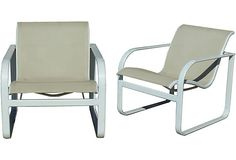 Brown Jordan Lounge Chairs - art of the Quantum Collection by Brown Jordan, with white powder-coated aluminum frames and beige, contoured mesh sling seats. The Quantum collection, designed by Richard Frinier in 1983, has received numerous prestigious design awards.