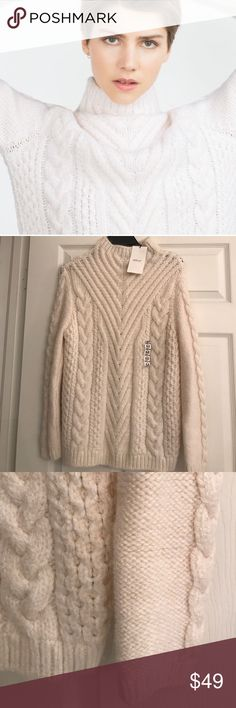 ZARA IVORY CHUNKY CABLE SWEATER My camera makes this look darker than it is. It's actually a beautiful ivory.. and the cable work on this sweater is just gorgeous!! Brand new with tags. Zara Sweaters