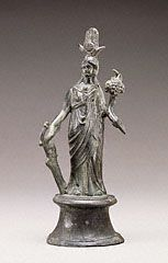 An ancient Roman bronze statuette of Isis-Fortuna; she has attributes of the goddess Isis (the headdress and Isis knot), and those of Fortuna (the rudder and cornucopia). (J Paul Getty Museum)
