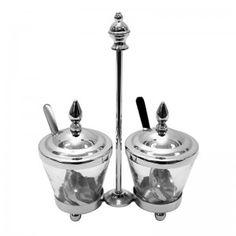 Elegancki oraz praktyczny zestaw składający się z 2 pojemniczków z łyżeczkami . Wymiary: