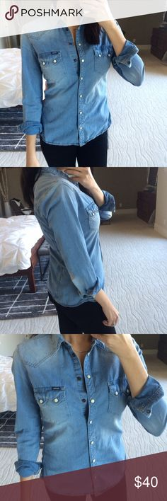 Organic denim button down Worn once! It's too tight in the chest for me. Super cute 100% organic cotton denim shirt with button sleeves. Tag is a small but runs small fitting like an XS. A great essential for every day. No trades. kuyichi Tops Button Down Shirts