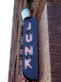 Junk Neon Sign...gotta love the garbage can on top!!!