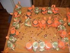 This is a 15th birthday party cake, camo cake with orange frosting baked in jelly jars with napkins placed under lid and spoon duct taped to jar, take off lid put scoop of ice cream on top of cake and you have cake, ice cream, spoon and napkin all in one. REDNECK BIRTHDAY PARTY