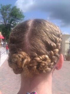 cute renissancy hair two braids in the back the came into a bun at the end