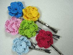 Hairpins with a two ply cotton crochet flower (approximately 25mm in diameter) in a vareitey of colours to choose from. There are 28 colour flowers in one inclusive photograph (one colour each) and 10 more in the other (changing colors). Just give me your choices' numbers counting from  the up downwards and from left to right.