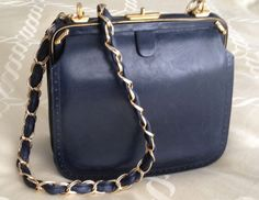 French clutch with chain and leather weave strap.