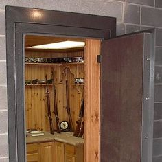 walk in gun safe - a good idea for the next house with room for cleaning, etc.