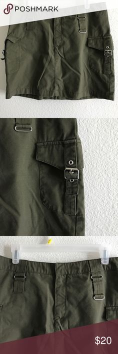 Mossimo Olive Green Cargo Skirt Size 14 NWOT Mossimo Olive Green Cargo Skirt Size 14 NWOT  Fabric: 77% Cotton, 23% Polyester. Waist: 16 Length: 15 No damages and smoke free. Mossimo Supply Co. Skirts Mini