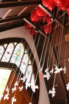 Pentecost, The Holy Spirit Descended like a Dove. Cut out on cardstock, doves, decorated by the Sunday School, with handwritten scriptural verses by the adults, attached to helium balloons (red), symbolic of the tongues of fire that were on each of the believers. These are waiting in the narthex entryway on Pentecost Sunday, and after the service, one is taken by each member, and released outside, symbolic of the releasing of the Holy Spirit in our own lives.