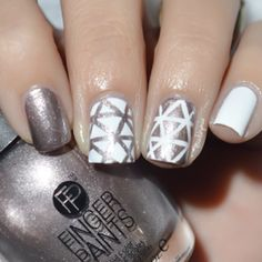 Inspiration is everywhere and recently all the beautiful trends seen in home décor - the whites, grays, sparkles and rose gold accents are simply to die for. This season keep your eyes open because inspiration is everywhere!In this tutorial Sheily Mae created a gorgeous Geometric Metallic nail design that we can't wait to copy!