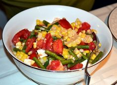 A refreshing late-summer salad of corn, tomatoes and fresh mozzarella.
