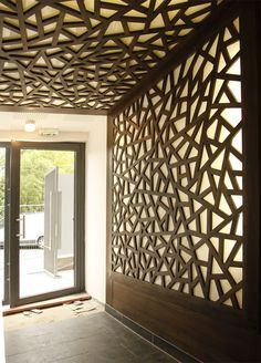 modular office wall design lazer cut areas with light coming through from behind i