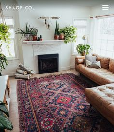 Essential Jewels & Earth:: Indigo & Burgundy kilm paired with caramel leather sectional lots of plants textural throw pillows and a chalky white backdrop. - March 03 2019 at Boho Living Room, Home And Living, Living Spaces, Living Room Decor Eclectic, Bohemian Living, Burgundy Living Room, Home And Deco, Living Room Inspiration, Home Decor
