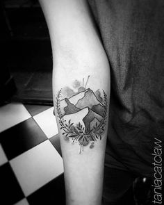 Sketch work mountain tattoo on the right inner forearm. Tattoo...