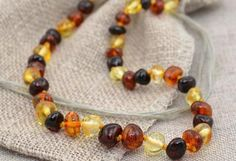 Help new moms and dads get their babes over the monumental hurdle of cutting new teeth by gifting them with a healing amber baby teething necklace.