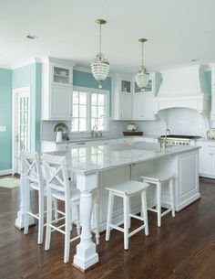 If theres anything better than a crisp white kitchen its one with a little bit of turquoise in the mix! Love how the pretty paint color (Benjamin Moore Wythe Blue HC-143) complements