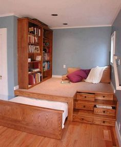 Blue and white bedroom. Raised platform. Hideaway bed. Built in drawers. Wooden bookshelf. Ruda Penny on imgfave.