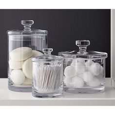 These glass canisters are a nice way to keep things organized but still in view #bridalregistry #bathroom