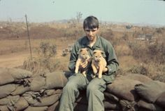 Soldiers with puppies in the midst of the Vietnam War