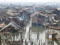 Makoko slums Makoko slums located in the lagoon on the edge of the Atlantic Ocean, just next to modern buildings, Lagos, the largest city in Nigeria and the main commercial and industrial center. In these slums, sprawled along the coastline for several kilometers in fragile wooden huts are thousands of people. There are no official records and census, but estimated to live here approximately 150,000 - 250,000 people. (via masterok)