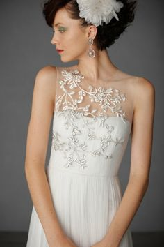Elysium Gown. beautiful details, if the white flower in her hair was attached to a small net veil it would be perfect!