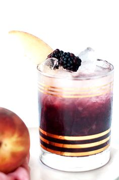 We're saying goodbye to Summer and hello to Fall with this peach and blackberry bramble cocktail recipe that's fitting for both!