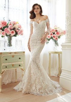 Off-the-shoulder lace and misty tulle trumpet gown with sheer lace three-quarter length sleeves and sweetheart bodice | Sophia Tolli | https://www.theknot.com/fashion/y11632-riona-sophia-tolli-special-occasion-wedding-dress | https://moncheribridals.com/collections/wedding-dresses/sophia-tolli/?utm_source=theknot.com&utm_medium=referral&utm_campaign=theknot&utm_content=gallery