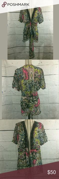CAbi Sheer Tie Front Sheer Chiffon Blouse CAbi Sheer Tie Front Sheer Chiffon Blouse Beaches of St. Tropez #543 Sz XL  Excellent used condition. No stains or holes.   About 19.5 inches pit to pit. 31 inches long.   LB CAbi Tops Blouses