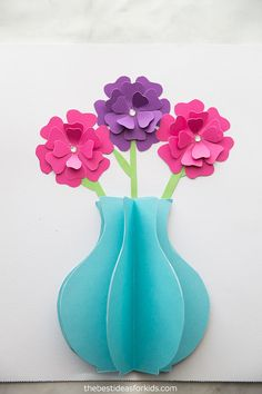Paper Flower Craft Paper Flower Craft - such a pretty paper craft for kids! Paper Flower Craft This adorable paper flower craft is perfect for welcoming spring in. Paper Flower Vase, Paper Vase, Tissue Paper Flowers, Diy Paper, Flower Vases, Spring Crafts For Kids, Paper Crafts For Kids, Butterfly Crafts, Flower Crafts