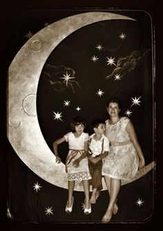 Vintage moon cutout, photo booth prop that my cousins Jared & Luke made for my niece Lainy\'s wedding!