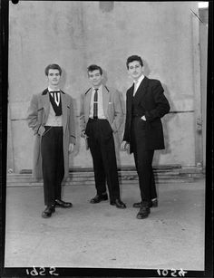 "TEDDY BOYS - the real thing- who visited ""The Post"" to demonstrate the authentic version of this youthful London craze. David Kelly (left) is in ""Mississippi gambler style"" Tony Griffith (middle) is true to the trend though in no particular style, and Ronald Bunting is in exact replica of Edwardian Fashion."
