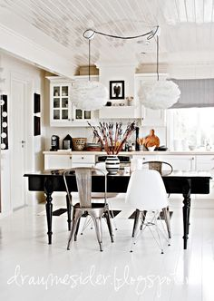 black dining table white kitchen