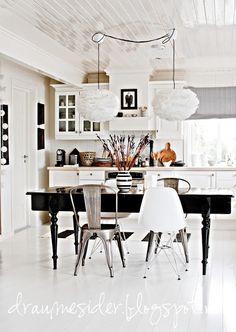 black dining table white kitchen