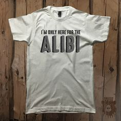"""I'm Only Here For The Alibi"" Unisex Graphic Tee from Grizzly Where"