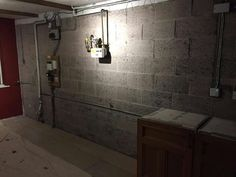 Second aspect of bare garage wall prior to construction of cabinets