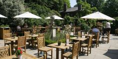 If you can get to Hampstead Heath early, head up to the Brew House for one of its famous cooked breakfasts, then potter around the two terraces until you find the right combination of parasol shade and sunshine: http://www.timeout.com/london/restaurants/brew-house