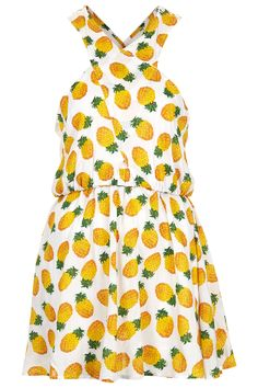 Topshop White Pineapple Print Cover Up - We suspect this cutesy pineapple print number is a lot more fun throwing on an old t-shirt over your beachwear.