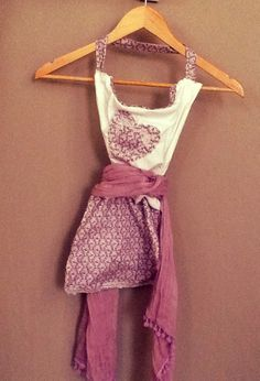 Lilac love apron tied with a pom-pom scarf and hand sewn by Creative Hands #apron #sewing #scarf #lilac #purple