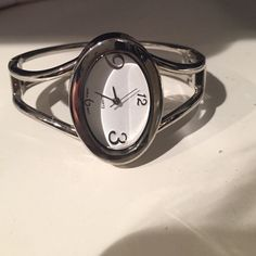 Bangle Bracelet Watch Silver bracelet watch with an oval face. Needs a new battery. Accessories Watches